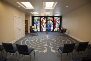 room with labyrinth and stained glass windows
